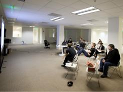 Tech explosion:  Employees at Tagged are adapting to a new work space as the company expands in downtown San Francisco.