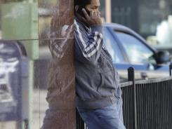 An unidentified man uses a cellphone in Oakland, Ca., in June. Commuters were affected when San Francisco transit officials cut off underground cellphone service at several stations Thursday to thwart a planned protest over the recent fatal shooting of a 45-year-old man by transit police.