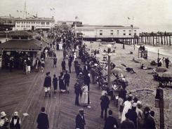 "Photographed around 1920, this image showing the Asbury Park, N.J., boardwalk was included in the December 2001 exhibit  ""1920-1965 Attractions of the Jersey Shore"" at the Ocean Township (N.J.) Historical Museum."