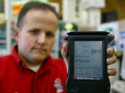 The IDlogix, a handheld scanner that reads bar codes and electronic strips on the back of most states' driver's licenses.