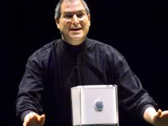 Steve Jobs showing the Cube at Macworld Expo in 2000.