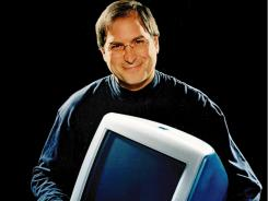 Apple CEO Steve Jobs holding an iMac computer in 1998.