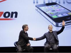 Tim Cook (right), Apple's new CEO, with Verizon Wireless CEO Dan Mead at an event in January,