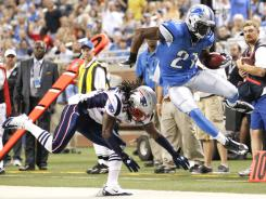 Detroit Lions running back Aaron Brown is forced out of bounds by New England Patriots safety Sergio Brown.