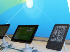 The Amazon Kindle and other tablets on the new Emerging Devices retail wall at AT&T headquarters in Atlanta.