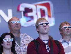 Visitors wear 3D glasses while watching a presentation of 3D Smart TV. Some devices are starting to have 3D capabilities without the glasses.