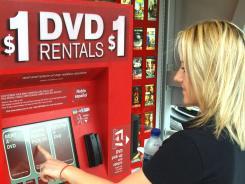 A customer uses a Redbox kiosk.