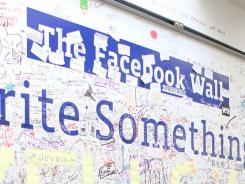 'The Facebook Wall' at Facebook headquarters in Palo Alto, Calif. Along with a major site overhaul and redesign, a major update to Facebook's  iPhone app and launch an iPad app could come soon.