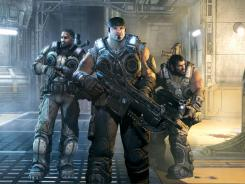 "Main character Marcus Fenix, center, and fellow ""gears"" Jace Stratton (left) and Domingo Santiago (right)."