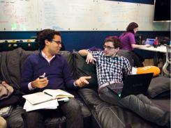 Harvard juniors, Peter Boyce, left, and Alec Guzov, attend a Hack Night in Cambridge, Mass.