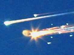 Debris from the space shuttle Columbia streaks across the sky over Tyler, Texas.