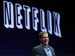 Netflix CEO Reed Hastings greets the audience at the Apple Worldwide Developers Conference, in San Francisco.