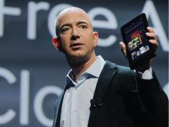 Amazon founder Jeff Bezos holds the new Amazon tablet called the Kindle Fire.