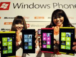 Models show off the Windows Phone in Tokyo.