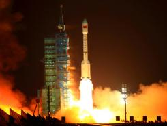 China's Long March 2F rocket carrying the Tiangong-1 module, or 'Heavenly Palace.'