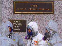 Hazmat workers prepare to enter the Senate's Hart building in November 2001 to check for contamination.