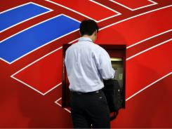 A customer uses a Bank of America ATM in Charlotte, N.C.