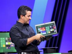 Microsoft executive Michael Angiulo shows a laptop running Windows 8.