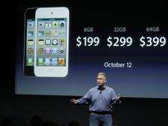 Apple executive Phil Schiller talks about the new iPhone during the announcement at Apple headquarters in Cupertino, Calif.
