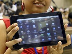 Indian student poses with the supercheap 'Aakash' tablet computer.