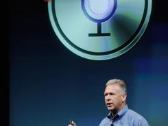 executive Phil Schiller speaks about the  voice recognition app called Siri during the company's presentation on Tuesday.