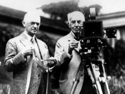 Kodak founder George Eastman, left, and Thomas Edison pose with their inventions in a photograph taken in the late 1920s.