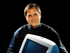 Groundbreaking:  Apple CEO Steve Jobs with an iMac in 1998, the year that the iMac and the PowerBook 3G were announced.