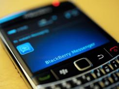 "This file photo taken Sept. 8, 2011, shows a BlackBerry smartphone using the ""Messenger"" service, in Berlin."