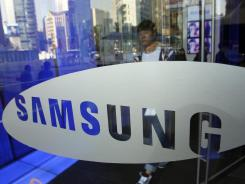 A visitor passes by the logo of Samsung Electronics at its headquarters in Seoul, South Korea.