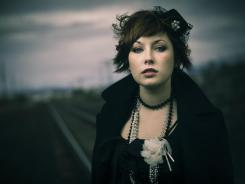 Kevin Kubota used a deserted train track, two flashes, an Octodome soft box, a diffusion panel and a neutral density filter to make this photo.