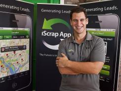 Tom Buechcel, owner of Rockaway Recycling, displays the iScrap app on his phone at his Rockaway, N.J., office.