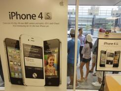 People line up to purchase an Apple iPhone 4S at a Sprint store in San Francisco.