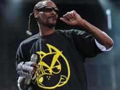 In a July 7, 2011 file photo, hip-hop artist Snoop Dogg performs on stage at the Balaton Sound festival in Zamardi, Hungary. Snoop Dogg is one of the celebrities who have been paid to promote a product on Twitter.