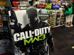 A cardboard display advertises the highly anticipated video game 'Call Of Duty: Modern Warfare 3' at a GameStop store.