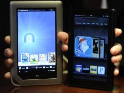 Barnes and Noble Nook (left) and Amazon's Kindle Fire.