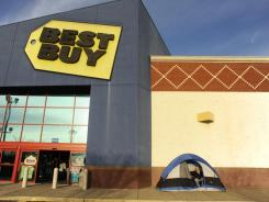 Shoppers camp outside the Best Buy in Central Park in Fredericksburg, Va., for Black Friday last year.