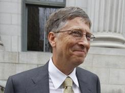 Bill Gates leaves federal court after his first day of testimony to defend Microsoft against antitrust allegations.