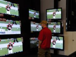 Customer Brad Pauley, of Westchester, Calif., looks over large screen TVs.