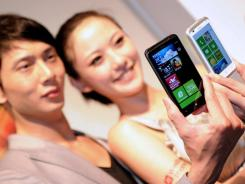 Models pose with the HTC Titan and Radar.