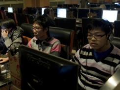 People surf the internet in in Shanghai, China.