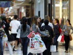 People shop at Dadeland Mall in Miami.