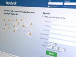 The Facebook home page appears on a computer screen.