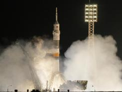 The Soyuz-FG rocket booster with Soyuz TMA-03M space ship carrying a new crew to the International Space Station, ISS, blasts off from the Russian leased Baikonur cosmodrome in Kazakhstan.