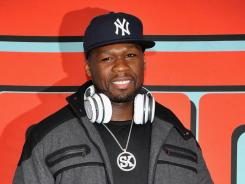 50 Cent promotes the new STREET by 50 & SYNC by 50 headphones at J&R Music World in New York City.