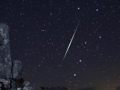 A meteor explodes over the Mojave Desert in California.