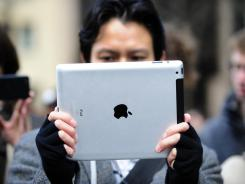 A man test the iPad 2 at an Apple store. Apple could release the iPad 3 sooner rather than later.
