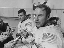 Apollo 13 commander James Lovell, foreground, speaks during a news conference in Cape Kennedy, Fla. before the spacecraft launched on its ill-fated journey to the moon.
