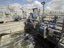 Mechanic Phillip Castro does a routine inspection of the water treatment systems at a plant in San Antonio.