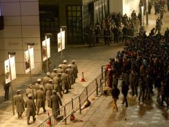 Police seal off the area around an Apple store in Beijing.