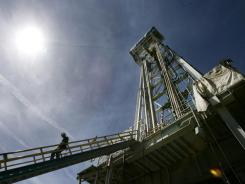 In this May 16, 2008, photo, a worker steps down from the drilling platform at the Newberry Crater geothermal project near LaPine, Ore.